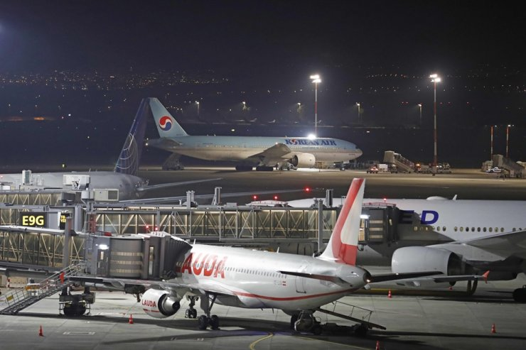 A Korean airplane which arrived from Korea is pictured after landing at Ben Gurion International Airport on Feb. 22, 2020. Israel refused to allow some 200 non-Israelis to disembark from a plane which arrived from Korea, as part of measures against the new coronavirus. AFP