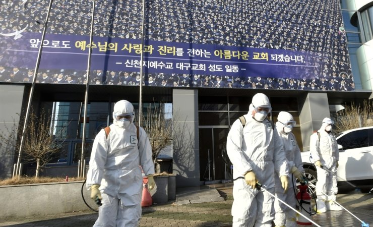 Quarantine authorities disinfect Sincheonji church in Daegu. / Yonhap
