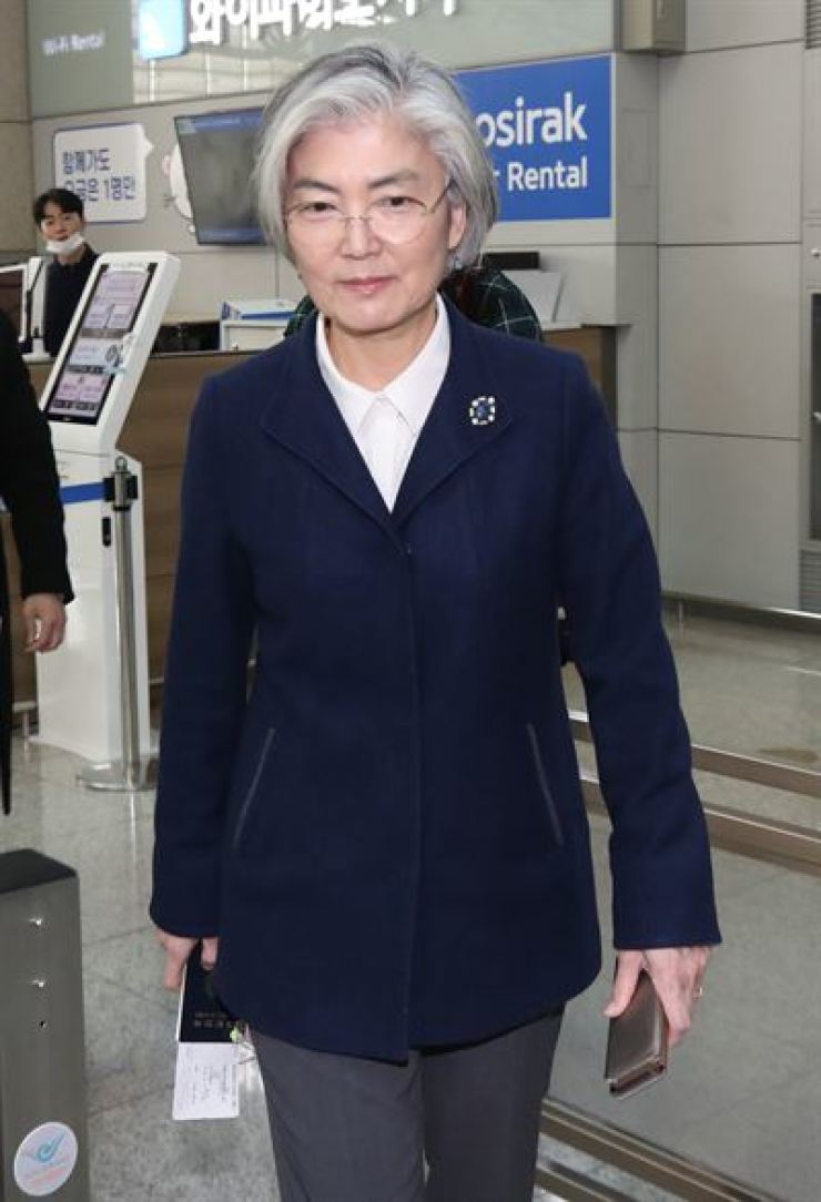 Foreign Minister Kang Kyung-wha walks through Incheon International Airport, Thursday, before leaving for Germany to attend the Munich Security Conference. / Yonhap
