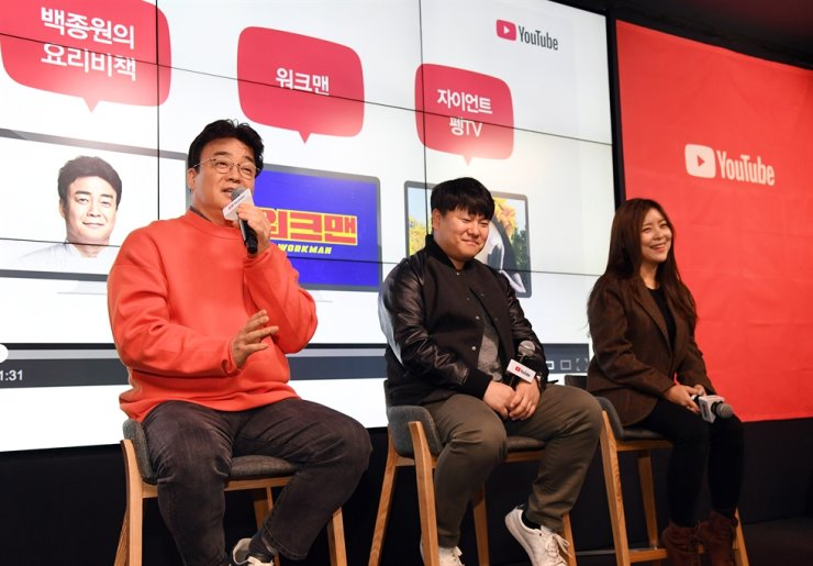 Chef and TV personality Baek Jong-won, left, speaks during YouTube's roundtable discussion, Friday, held in Samsung-dong, Seoul. Next to him are producers Ko Dong-wan, and Leeseul Ye-na. Courtesy of YouTube