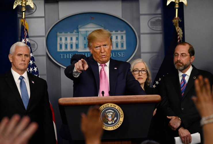 US President Donald Trump takes questions from reporters at a news conference on the COVID-19 outbreak at the White House on February 26, 2020. - US President Donald Trump on Wednesday defended his administration's response to the novel coronavirus, lashing the media for spreading panic as he conducts an evening news conference on the epidemic. /AFP