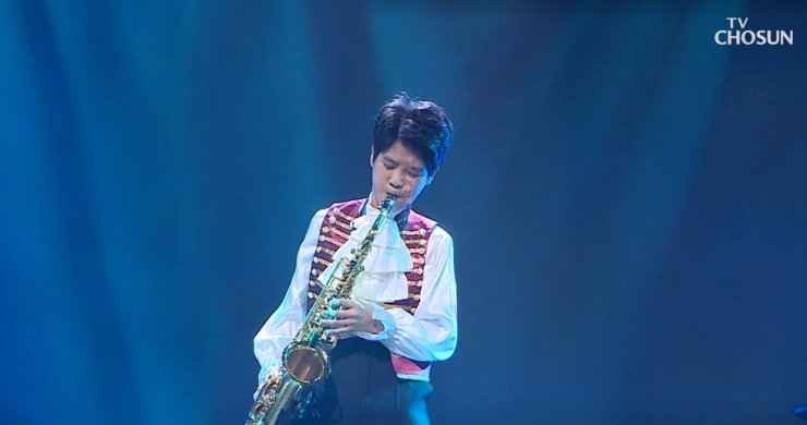 This captured image shows Jeong Dong-won, the youngest contestant of TV Chosun's talent search show 'Mr. Trot,' as he plays the saxophone in the competition. / Korea Times file