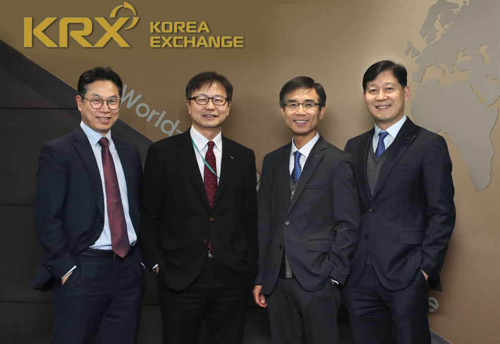 Heads of IT and overseas departments of the Korea Exchange (KRX) pose prior to an interview with The Korea Times. From left, Director General of Global Business Jung Kyoo-il, Director General of IT Management Lee Chang-jin, Executive Director and CIO Chung Geun-young, and Director General of IT Strategy Kim Dae-young. / Courtesy of KRX