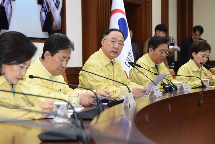 Deputy Prime Minister and Finance Minister Hong Nam-ki, third from left, speaks during a ministerial meeting at the Government Complex Seoul, Monday. / Courtesy of Ministry of Economy and Finance