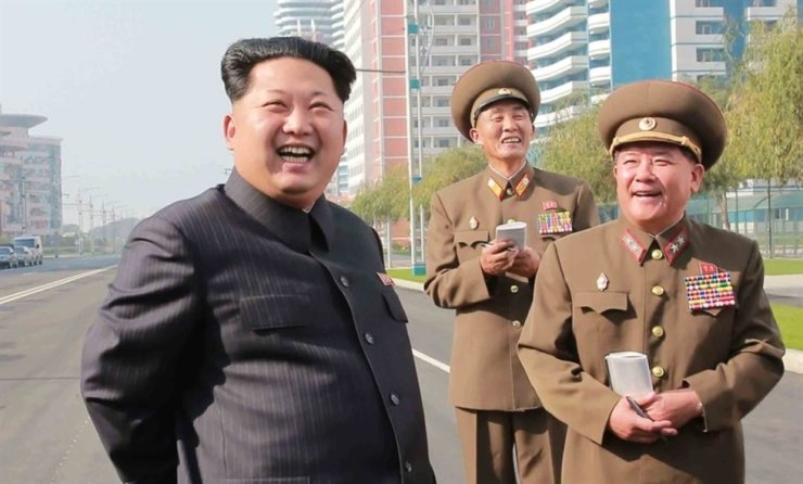 North Korean leader Kim Jong-un, left, smiles while taking a look at its science street in Pyongyang, in this file photo taken on October 2015. Yonhap