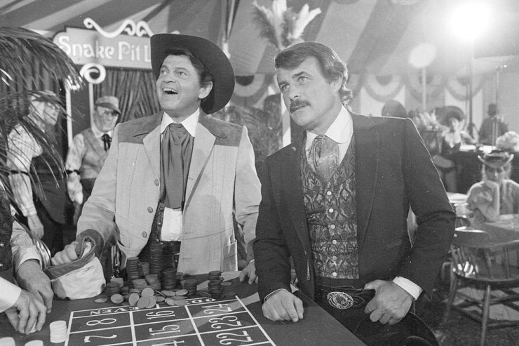 In this June 4, 1980, file photo, actors Ross Martin, left, and Robert Conrad, right, are shown while filming a scene of the motion picture 'More Wild, Wild West,' in Los Angeles. Conrad, the rugged, contentious actor who starred in the hugely popular 1960s television series 'Hawaiian Eye' and 'The Wild, Wild West,' has died at age 84. AP