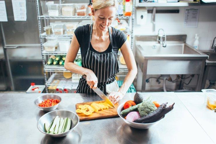 Karen Sylvana prepares vegan meals in the kitchen./Robert Michael Evans
