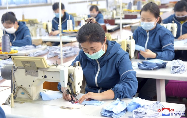 In this undated photo distributed Feb. 7 by the North Korean government, workers produce face masks to help prevent spread of a new coronavirus in Pyongyang. AP