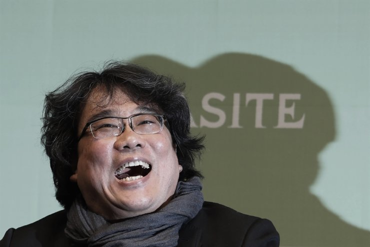 Bong Joon-ho, director of Oscar-winning 'Parasite,' laughs during a press conference in Seoul, Wednesday, Feb. 19, 2020. Bong said Wednesday 'the biggest pleasure and the most significant meaning' that the film has brought to him was its success in many countries although the audiences might feel uncomfortable with his explicit description of a bitter wealth disparity in modern society. AP