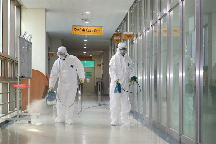 Quarantine officials disinfect a dormitory for foreign students at Chosun University in Gwangju, Thursday, amid coronavirus fears, ahead of the start of the spring semester next month. /Yonhap