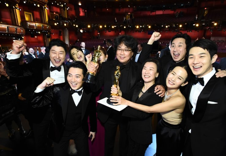 In this handout photo provided by A.M.P.A.S. Best Picture Award winners for 'Parasite' pose onstage during the 92nd Annual Academy Awards at the Dolby Theatre on Feb. 9, 2020, in Hollywood, Calif. AFP