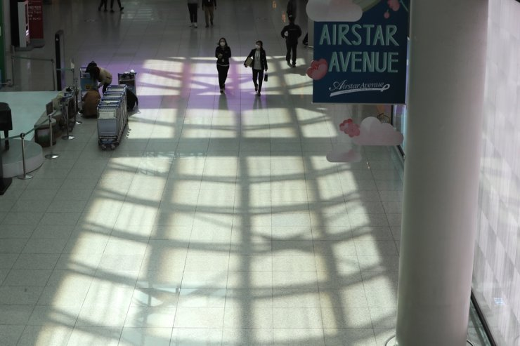 Incheon International Airport looks empty as the new coronavirus epidemic discourages overseas travels./ Yonhap