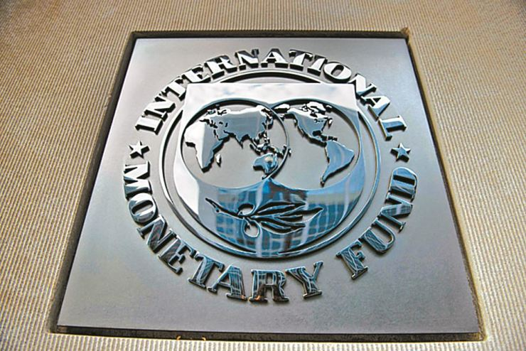 In this file photo taken on June 30, 2015 a logo is seen outside the headquarters of the International Monetary Fund in Washington, DC. - The world economy is facing 'severe' economic damage from the coronavirus pandemic that could be even more costly than in 2009 and will require an unprecedented response, IMF chief Kristalina Georgieva said March 23, 2020. /AFP