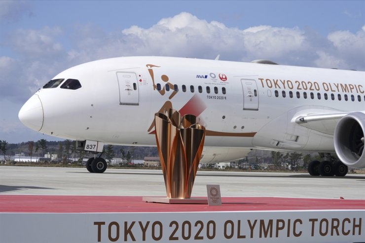 A plane carrying the Olympic flame arrives before Olympic Flame Arrival Ceremony at Japan Air Self-Defense Force Matsushima Base in Higashimatsushima in Miyagi Prefecture, north of Tokyo, Friday. The Olympic flame from Greece is set to arrive in Japan even as the opening of the the Tokyo Games in four months is in doubt with more voices suggesting the games should to be postponed or canceled because of the worldwide virus pandemic. AP-Yonhap