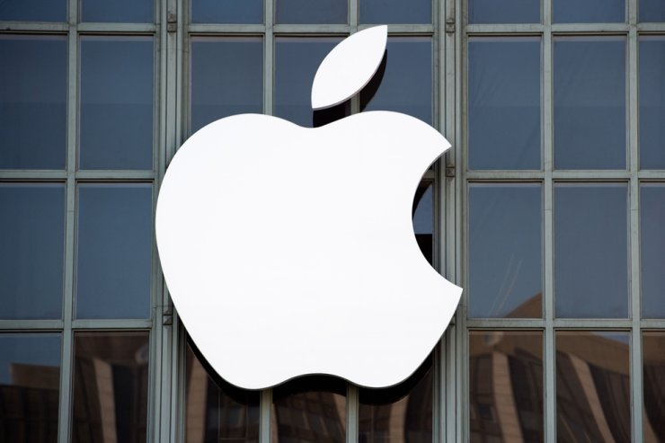 This file photo taken on Sept. 7, 2016, the Apple logo is seen on the outside of Bill Graham Civic Auditorium before the start of an event in San Francisco, California. Apple is closing all of its stores outside China until March 27 in a bid to slow the new coronavirus outbreak, CEO Tim Cook said. AFP