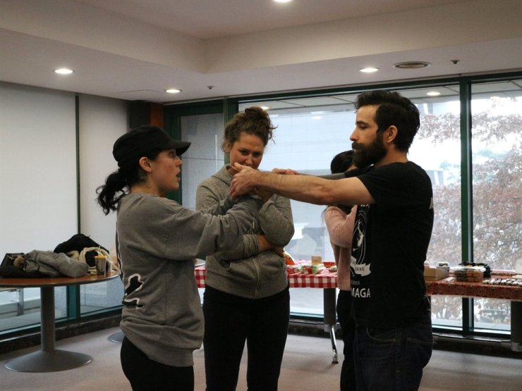 Gideon Roth, right, works with a student on hand-to-hand defense and combat/ Courtesy of Krav Maga Seoul