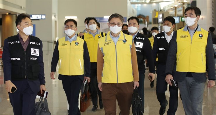 Government officials walk to the departure gate at Incheon International Airport, Thursday, to head for Vietnam to provide support measures for Korean citizens who have been quarantined at public facilities there following the Vietnamese government's toughened entry restrictions for travelers from Korea due to the COVID-19 epidemic. Yonhap