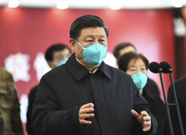 Chinese President Xi Jinping talks by video with patients and medical workers at the Huoshenshan Hospital in Wuhan in central China's Hubei Province, Tuesday, March 10, 2020. Xinhua via AP