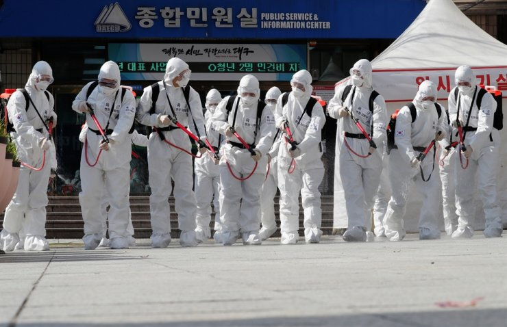 Korean soldiers wearing protective gear sanitize a city after the rapid rise in confirmed cases of the novel coronavirus disease of (COVID-19) in Daegu, southeast of the capital Seoul, March 2, 2020. Reuters