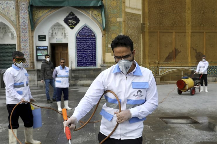 Workers disinfect the shrine of the Shiite Saint Imam Abdulazim to help prevent the spread of the new coronavirus in Shahr-e-Ray, south of Tehran, Iran, Saturday, March, 7, 2020. AP