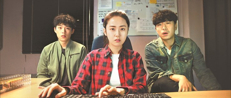 From left, actors Kim Sung-cheol, Heo Ga-yoon and Lee Si-eon in a scene from 'Search Out' / Courtesy of D&Y