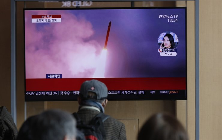 People watch a TV screen showing a news program reporting about North Korea's firing of projectiles with a file image at the Seoul Railway Station in Seoul, Monday, March 2, 2020. AP