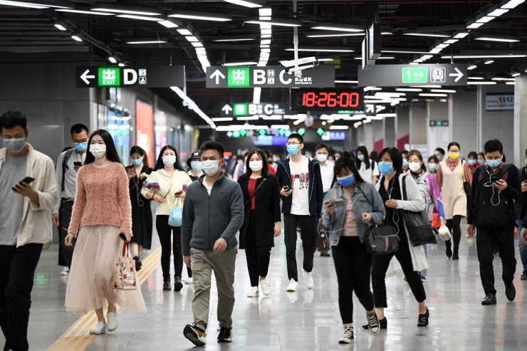 Passengers enter a subway station in Shenzhen, south China's Guangdong Province, March 18, 2020. Some of the city's subway stations, which were often overwhelmed with passengers during rush hours before the epidemic, have taken a variety of measures to avoid the congregation of passengers amid the coronavirus outbreak. (Xinhua/Liang Xu)