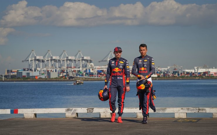 Max Verstappen, left, of the Netherlands and Red Bull Racing and Alexander Albon of Thailand and Red Bull Racing look on during the Aston Martin Red Bull Racing Cooler Runnings event ahead of the F1 Grand Prix of Australia at Station Pier in Melbourne, Australia, Wednesday. / EPA-Yonhap