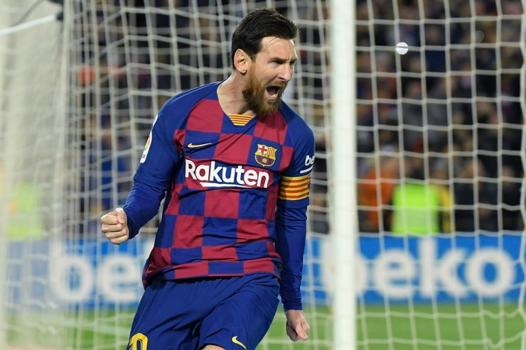 Barcelona's Argentine forward Lionel Messi celebrates after scoring a goal during the Spanish league football match between FC Barcelona and Real Sociedad at the Camp Nou stadium in Barcelona on March 7. Meanwhile Barcelona's Hospital Clinic said it had received a donation from FC Barcelona captain Lionel Messi to help it fight the novel coronavirus. While the hospital did not say how much money the player donated, Catalan sports daily Mundo Deportivo said it was one million euros. / AFP-Yonhap