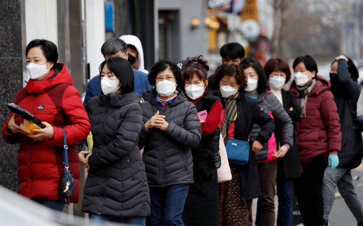 People line up to buy face masks in front of a drug store amid the rise in confirmed cases of the novel coronavirus COVID-19 in Daegu, Tuesday. Reuters