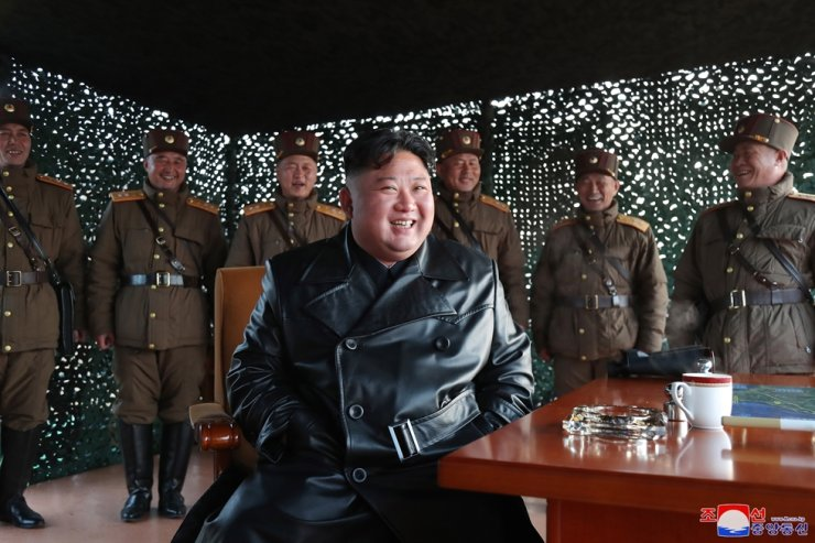 In this photo provided by the North Korean government, North Korean leader Kim Jong-un inspects military exercise at an undisclosed location in North Korea on Saturday, March 21, 2020. Yonhap