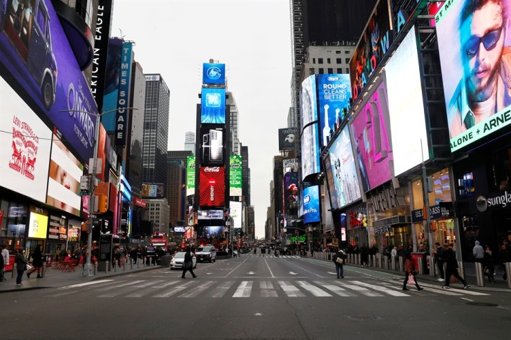 A nearly empty 7th Avenue in Times Square is seen at rush hour after it was announced that Broadway shows will cancel performances due to the coronavirus outbreak in New York, Thursday. /Reuters/