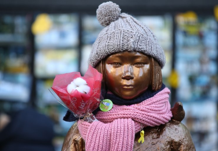 A statue symbolizing 'comfort women' in front of the Japanese embassy in Seoul / Korea Times file