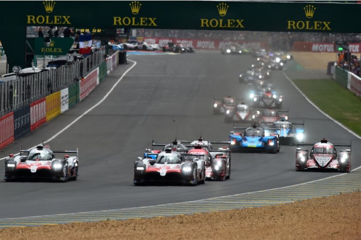 Drivers compete in the 86th edition of the 24 Hour race on June 16, 2018, at the Le Mans circuit. The Le Mans 24-hour endurance race, one of the traditional highlights of the motor racing calendar, has been postponed from June 13-14 to Sept. 19-20, 2020, because of the outbreak of COVID-19, caused by the novel coronavirus, organizers said on Wednesday. / AFP-Yonhap