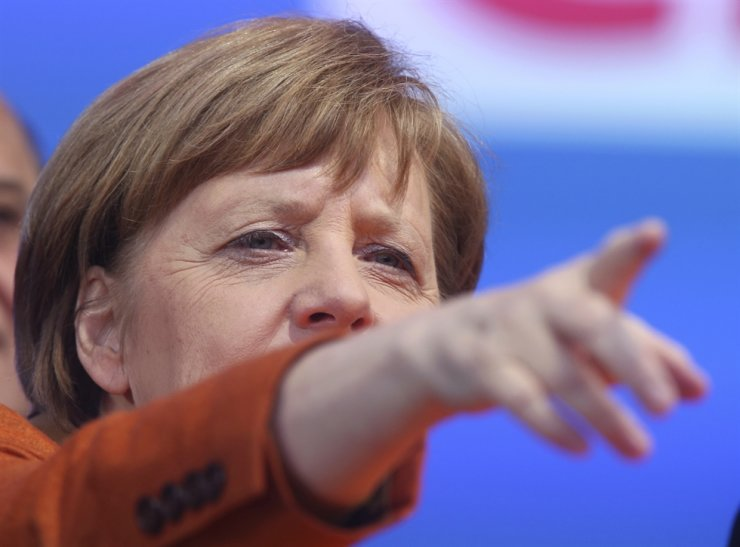 Picture taken March 23, 2017 shows German Chancellor Angela Merkel pointing during an election campaign of the Saarland Christian democrats, CDU, in St.Wendel, Germany. (AP Photo/Michael Probst)