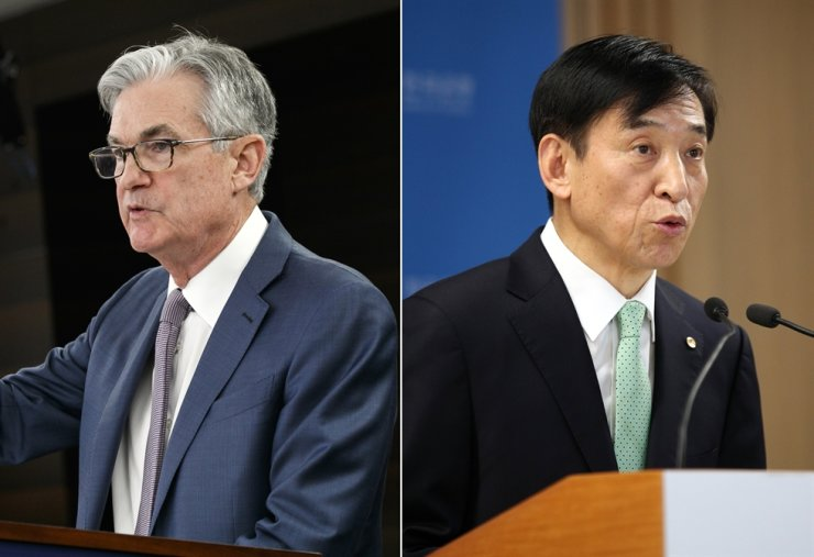 U.S. Federal Reserve Chair Jerome Powell, left, and Bank of Korea Governor Lee Ju-yeol / Korea Times file