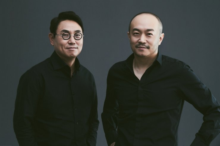 Kakao joint CEOs Yeo Min-soo, left, and Cho Soo-yong, were reappointed at the annual shareholders meeting held at the company headquarters in Jeju, Wednesday. Courtesy of Kakao
