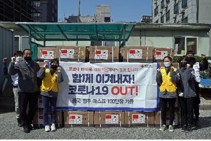 China has donated 1 million more surgical masks to help South Korea cope with the coronavirus outbreak, the Red Cross said Tuesday. Courtesy of Red Cross, Yonhap