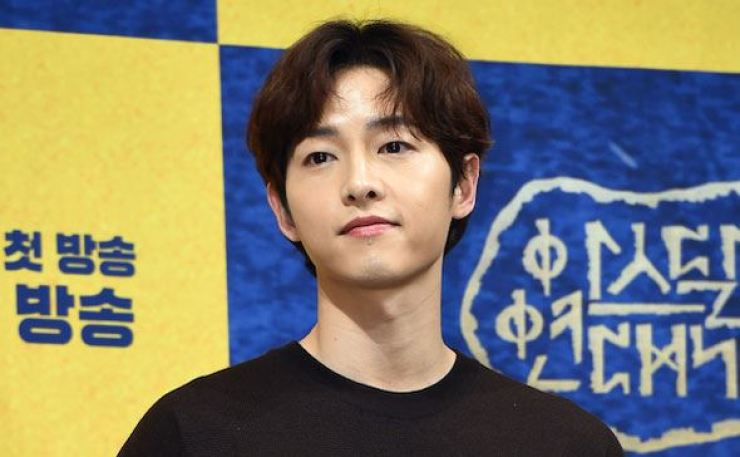 Actor Song Joong-ki returned to Korea from Colombia on Tuesday. Korea Times file
