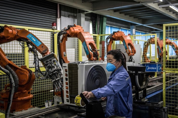 An employee works on an air conditioner production line at a Midea factory in Wuhan in China's central Hubei province in this March 25 file photo. AFP