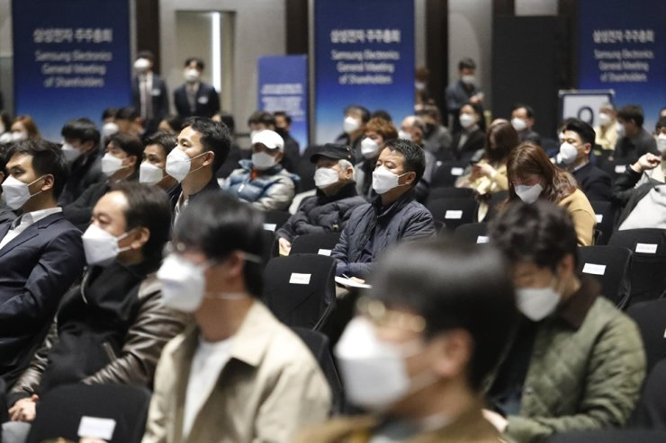 Shareholders wearing face masks of Samsung Electronics Co. attend the company's annual general meeting in Suwon, South Korea, Wednesday. AP-Yonhap