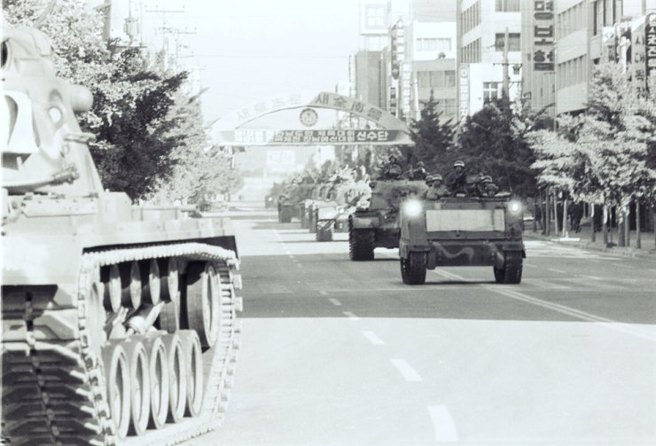 The main street in the southwestern city of Gwangju is filled with soldiers and tanks in this May 1980 file photo after the military brutally cracked down on the pro-democracy protests there. Nationwide martial law was declared shortly during the May 18 uprising. / Korea Times file