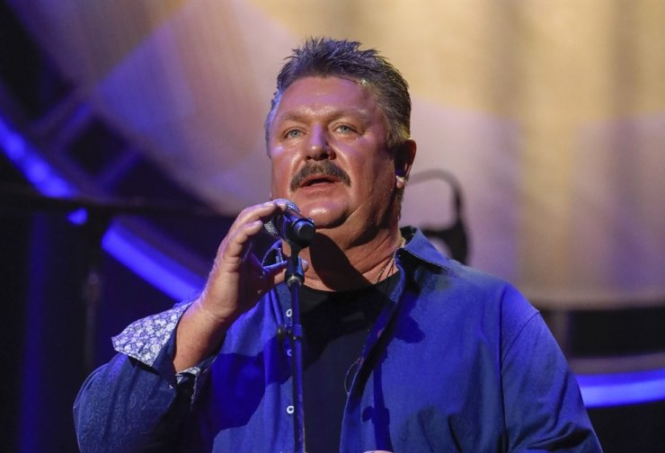 This Aug. 22, 2018, file photo shows Joe Diffie performing at the 12th annual ACM Honors in Nashville, Tenn. A publicist for Diffie says the country singer has tested positive for COVID-19. AP