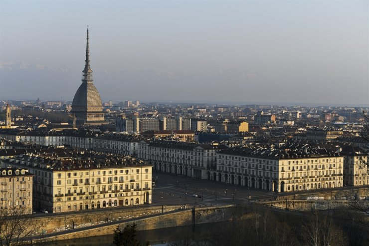 Buildings and streets in Turin, Italy, are seen during the lockdown due to the coronavirus, Saturday, March 21, 2020. Italian Premier Giuseppe Conte has told the nation he is tightening the lockdown to fight the rampaging spread of the coronavirus, shutting down all production facilities except those that are 'necessary, crucial, indispensable to guarantee essential goods' for the country. Conte said Italy is living through 'its gravest crisis since World War II.' AP