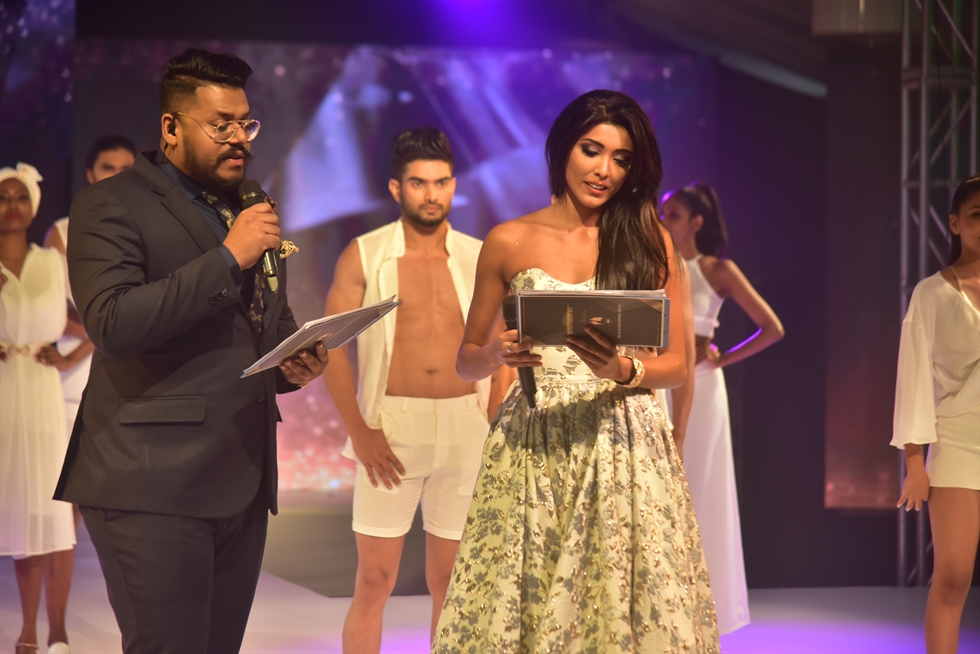 The two winners of FACE of Sri Lanka 2020, Sayuri Bhagyawi Jayarathna, left, and Yasiru Mihiran, right, with Badal Saboo, representative of the event's partner companies. Courtesy of Asia Model Festival Organizing Committee (AMFOC)