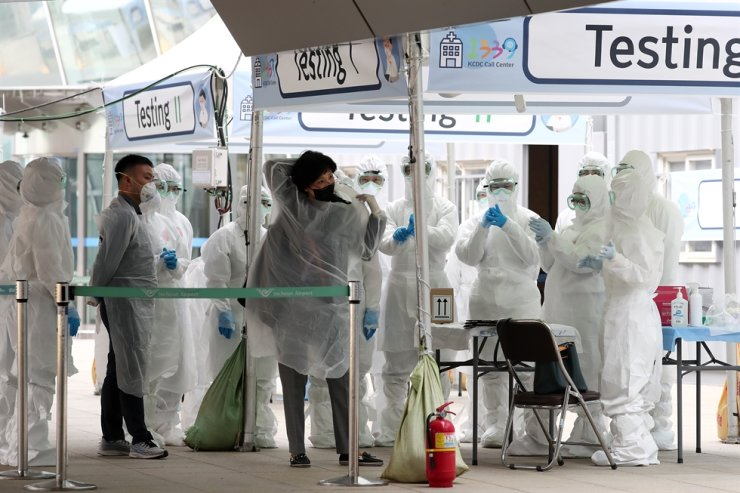 South Korea reported 125 new cases of the novel coronavirus Tuesday, up from 78 new cases a day earlier, bringing the nation's total infections to 9,786. Korea Times photo by Shim Hyun-chul