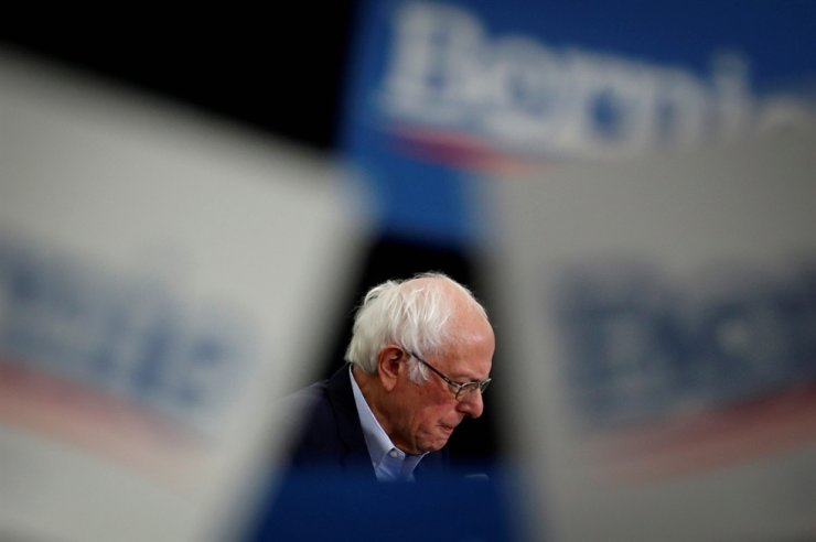 Democratic U.S. presidential candidate Senator Bernie Sanders is seen as supporters wave signs as he speaks at a campaign rally in Milford, New Hampshire, U.S., Feb. 4, 2020. Reuters