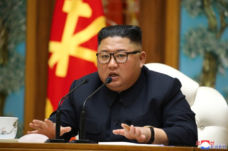 North Korean leader Kim Jong-un speaks during a political bureau meeting of the ruling Workers' Party, April 11, according to the North's state media reports the day after. A South Korean media outlet reported, Monday, that Kim received a cardiovascular surgery on April 12 and his condition was improving, while CNN reported he is in grave danger. Yonhap