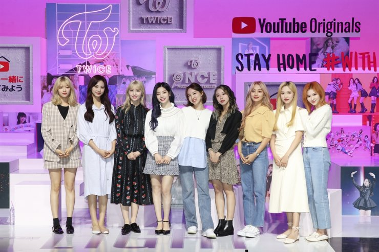 K-pop girl band TWICE's YouTube Originals documentary 'TWICE: Seize the Light' will be unveiled on Wednesday. Courtesy of JYP Entertainment