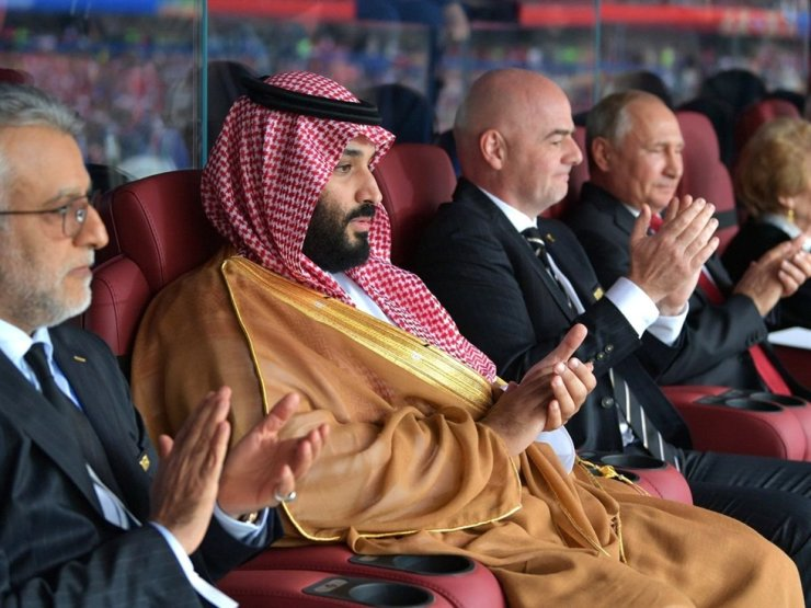 Seen above is Saudi Crown Prince Mohammed bin Salman, second from left, watching an international football match with FIFA President Gianni Vincenzo Infantino, third from left, and Russian President Vladimir Putin, first from right, during the 2018 Russia World Cup. / gettyimagesbank
